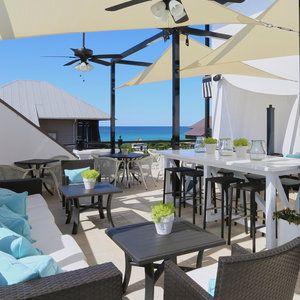 Rosemary Beach, Florida  With views of Rosemary Beach's beautiful homes, the town green, and the white sand-meets-turquoise Gulf, Havana Beach Rooftop Lounge is one stunning hangout. Located on top of The Pearl hotel, the lounge features bistro and commun