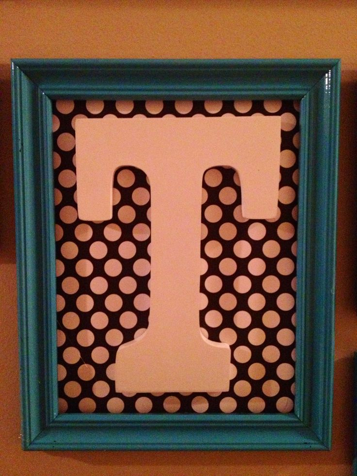 Wooden monogram letter framed with awesome fabric behind! Looks great in my hallway picture collage! :)