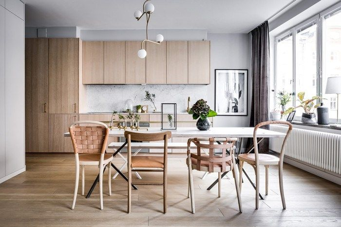 Inviting living kitchen with wood and brass - via Coco Lapine Design
