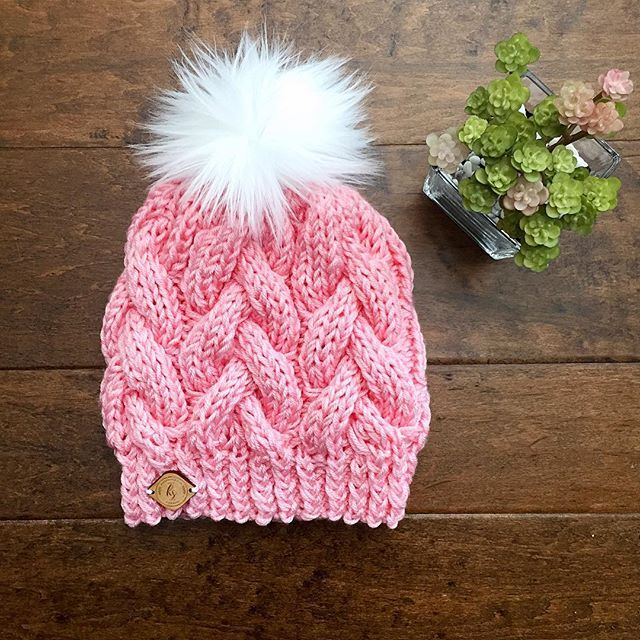Softest, squishiest, prettiest hat I'm a sucker for pink!! Going to list this one right now in my shop!☝ Coupon code GRANDOPENING15 for 15% off is still going.  Pattern credit: the amazing @premknits ~ ~ ~ ~ ~ ~ ~ #pompom #fauxfur #colourpop #yarnlove #yarn #pretty #cute #slouchyhat #slouchybeanie #braidedcablebeanie #braidedcables #knit #knitter #knitting #knittinglove #knitstagram #knittersofinstagram #knitting_inspiration #soft #easterhat #eastercolors #creativelifehap...