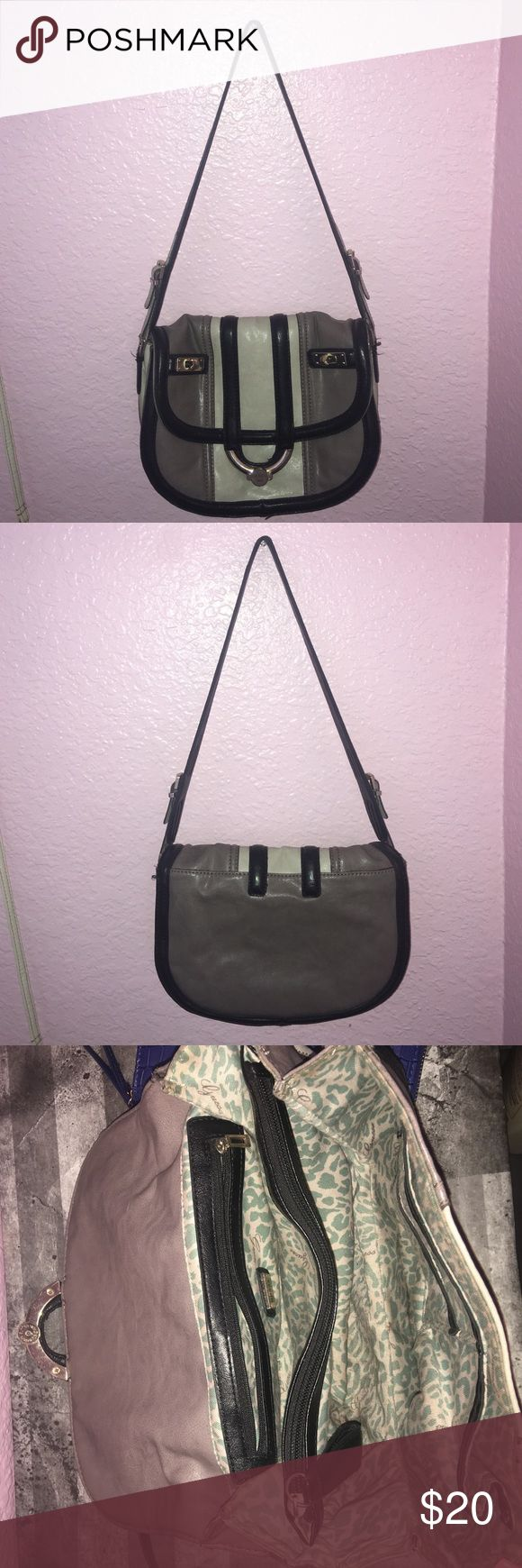 Guess bag Cute. I actually really like this bag but I don't get much use out of it so I'm deciding to sell it. Black/cream/cream grayish color. Make an offer. Guess Bags Shoulder Bags