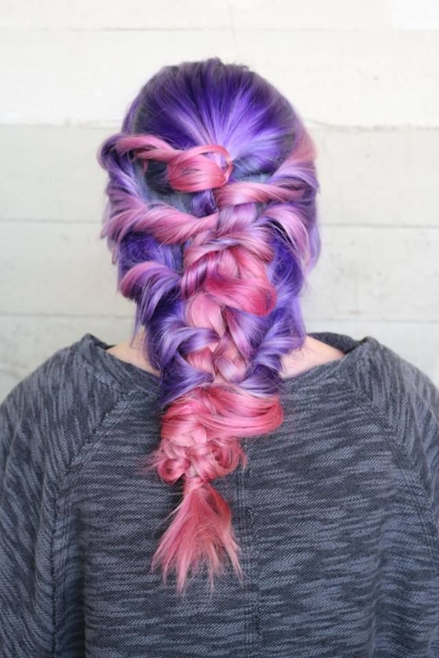 Purple and pink hair color adorned with a messy braid pink hair color purple hair color festival hair by Caroline Guiney www.instagram.com/hotonbeauty