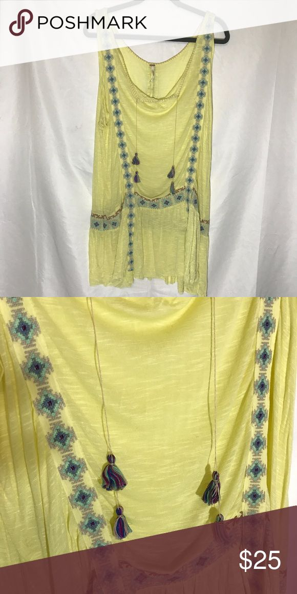 Free People yellow beach dress Free People yellow beach dress with tassel and embroidered details. Super cute as a dress or cover up! Band sits low on waist. Never worn. Free People Dresses Mini