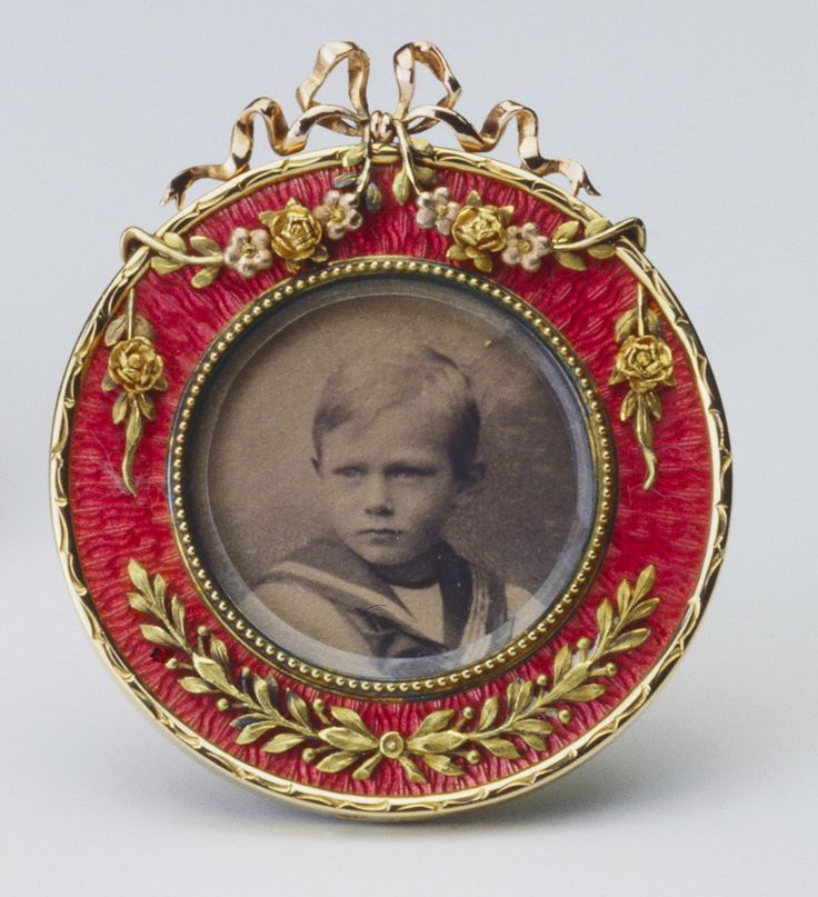 Frame with photograph of Prince Henry of Wales (later Duke of Gloucester), Fabergé, circa 1905-06, three colored gold, guilloché enamel, ivory
