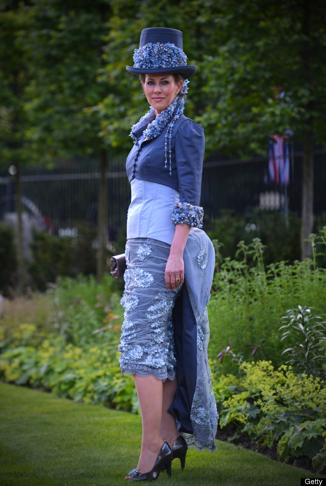 A race-goer wearing a flamboyant outfit poses for the media at the annual Royal Ascot horse racing event near Windsor, Berkshire on June 19, 2012. The five-day meeting is one of the highlights of global horse racing and the pinnacle of the English social calendar.