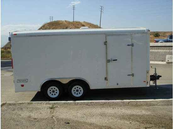 """2016 New Haulmark TST85X16WT2 Toy Hauler in California CA.Recreational Vehicle, rv, 2014 HAULMARK TST85X16WT2, THIS TRAILER HAS 2 3500LBS SPRING ELECTRIC BRAKE AXLES, EMERGENCY BREAKAWAY CABLE W/BATTERY, .030 POWDERCOATED ALUMINUM SIDING, 1-PIECE ALUMINUM ROOF, 3/8 PLYWOOD SIDE WALLS, 3/4"""" PLYWOOD FLOORING, 5000LBS SPRING ASSISTED RAMP DOOR W/16"""" EXT FLAP, LED SLIM TAIL LIGHTS, TRANSPORT PKG., 2 12VOLT DOME LIGHTS, 1 12VOLT WALL SWITCH, 1 14""""X14"""" NON-PWR ROOF VENT, 4 5000LBS RECESSED D-RINGS…"""