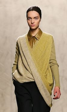 Doo.Ri Fall 2012 imagine it without the shirt underneath, the pants and the model. Amazing sweater.