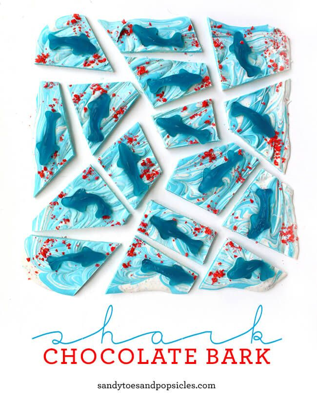 Celebrate Shark Week by making this fun and simple Shark Chocolate Bark. All you need to make it is chocolate, gummy sharks and some Pop Rocks!