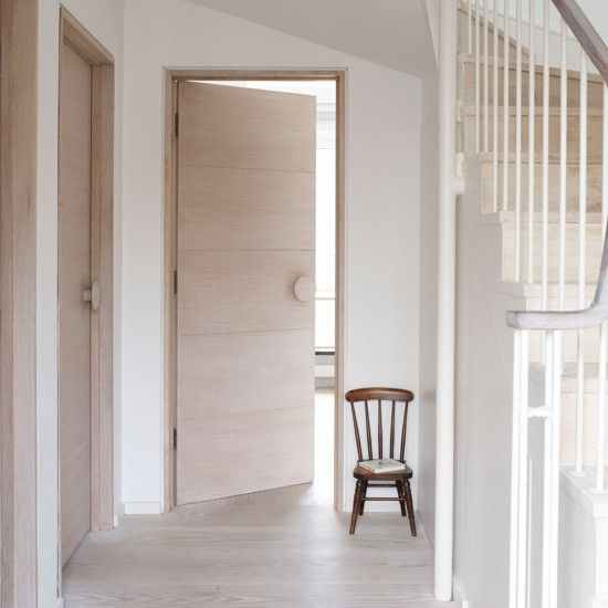 Minimalist hallway. Love the door handles, Could use the Muuto Dot coat hooks.