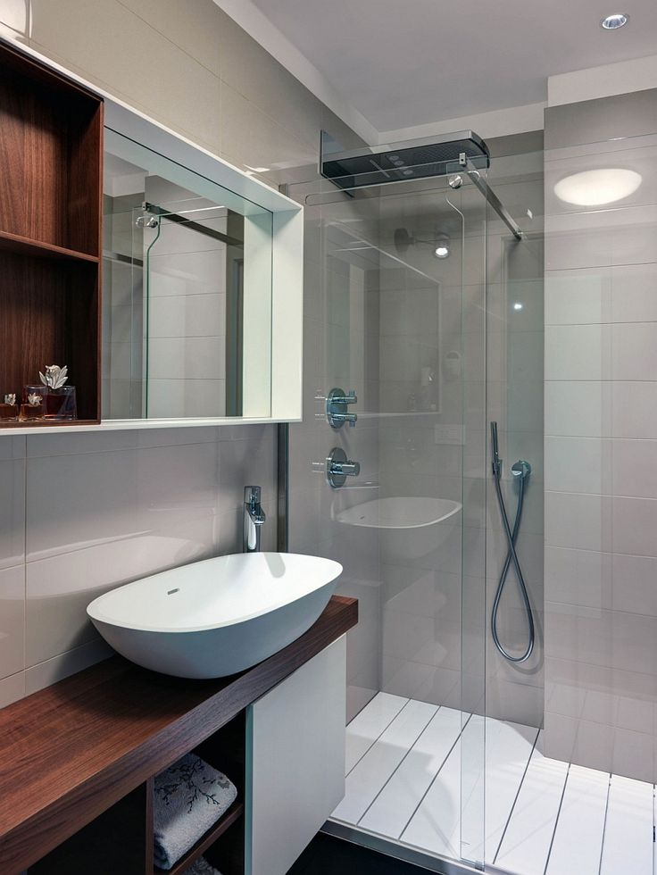 Apartments:Modern Bathroom With Compact Glass Shower Area With Vanity Bath Also Shelves Also Mirror Also Glass Shower With Ceramics Wall Also Bath Faucet Also Sink Bath In Luxury Apartment In Milan Modern Interior Design of Luxury Apartment in Milan To Inspire You