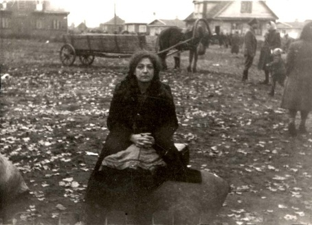 Kaunas, Lithuania. A woman waiting with her possessions before the deportation from the ghetto to camps in Estonia. 1943. In all, 2,709 Jews were removed from the ghetto. Children and elderly were shipped to Auschwitz; all others were sent to Klooga in northern Estonia. Almost no one survived the deportation.