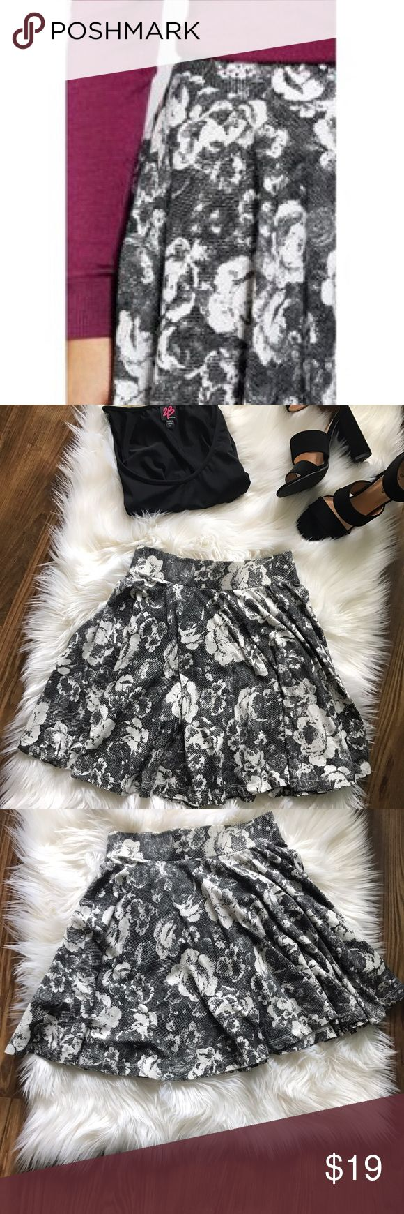 Pins & Needles Floral Skater Skirt In good condition. skater skirt by pins and needles. Cute paired with a shirt tucked in and some leggings or with a crop top. No holes or piling. Urban Outfitters Skirts Circle & Skater