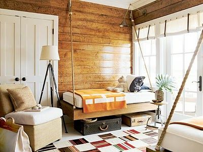 love the hanging bedand so much storage underneath be great on porch at cabin