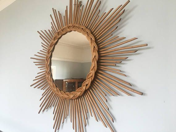 Stunning vintage sunburst rattan mirror in excellent condition. Plaited rattan frame. Very good vintage condition. Would hang well in any home.  Dimensions: Height - 23.25 inches/59 cms (at its highest)  Length - 16.5 inches/42 cms (at its widest)  Mirror diameter - 9.5 inches/24 cms  Check out my other items on www.etsy.com/uk/shop/verylastcentury  I do not make any money on shipping and will refund any excess. The shipping prices given are the most economical. ...