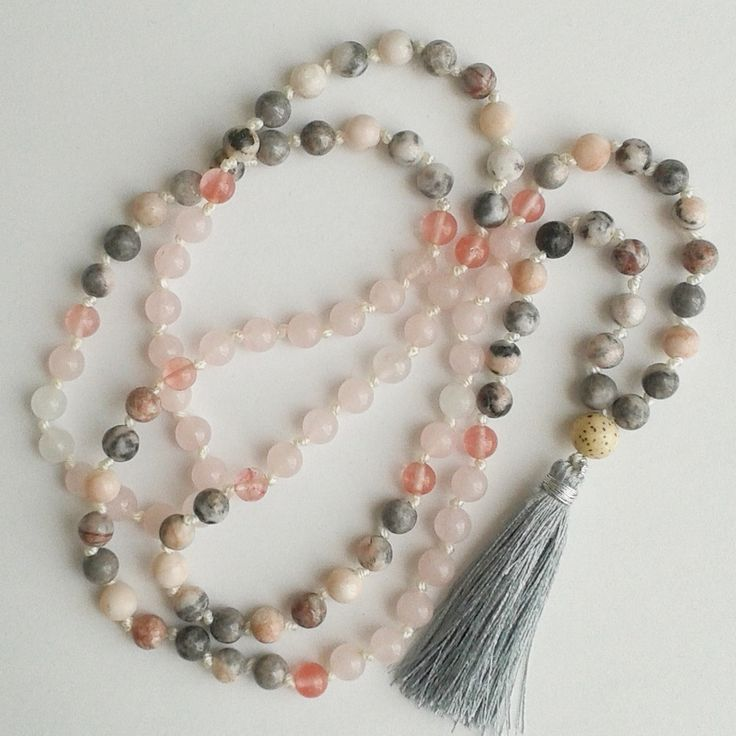 Pink zebra jasper combined with rose quartz, cherry quartz and a Thai silk tassel.  Pink zebra jasper acts as an encouraging stimulant which motivates and energizes you. It will help one overcome apathy and sets sets you into action so that you can achieve something fruitful. Absorbs negative energy and allows free flow of tranquility. Rose quartz has a very strong loving energy.This mala has 108 plus one beads, a true mala, hand knotted between each bead. each mala ...