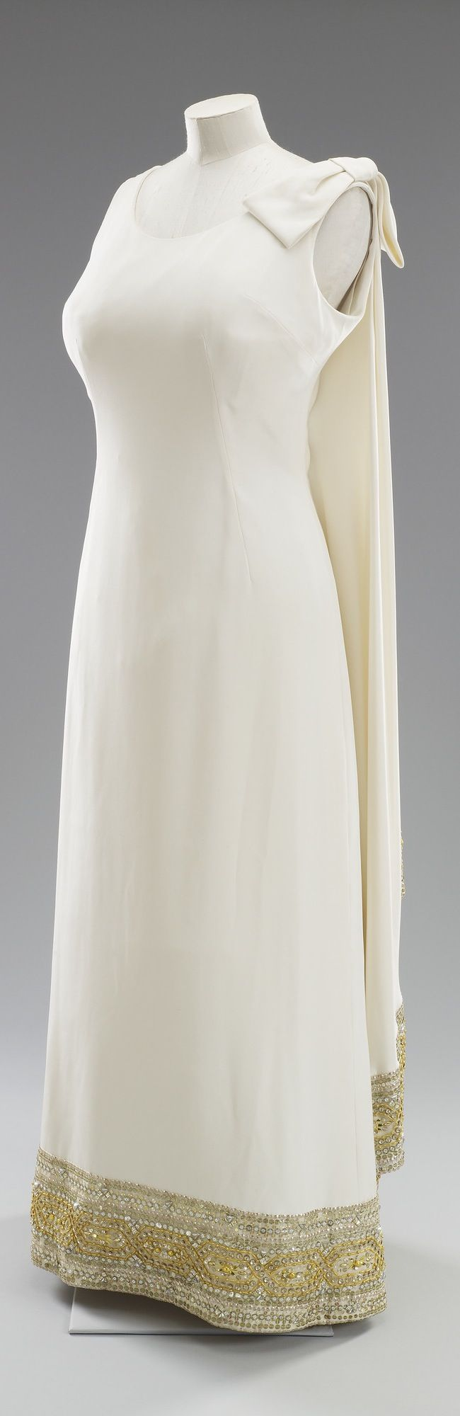 Evening gown, by Sir Norman Hartnell, 1967. Silk crêpe with gold and silver sequin and bead embroidery. Worn by H.M. Queen Elizabeth II. Royal Collection Trust/All Rights Reserved.