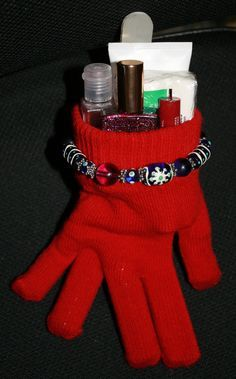 """Cute Christmas gifts for anyone. Fill dollar store gloves with various items: Bath & Body works hand sanitizer, hand lotion, cute emery board, key chain nail clippers (these are all """"hand items"""") Fill the fingers of the gloves with: Lip balm, roll-on perfume, pack of gum, other small items. Purse-size Kleenex would also be a good idea to add. Endless possibilities!"""