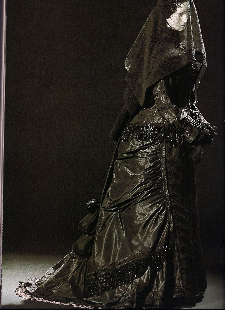 A Victorian mourning dress from the late 1800s. The wearer would have been past the fist stage of mourning when shiny fabrics like taffeta were not allowed.