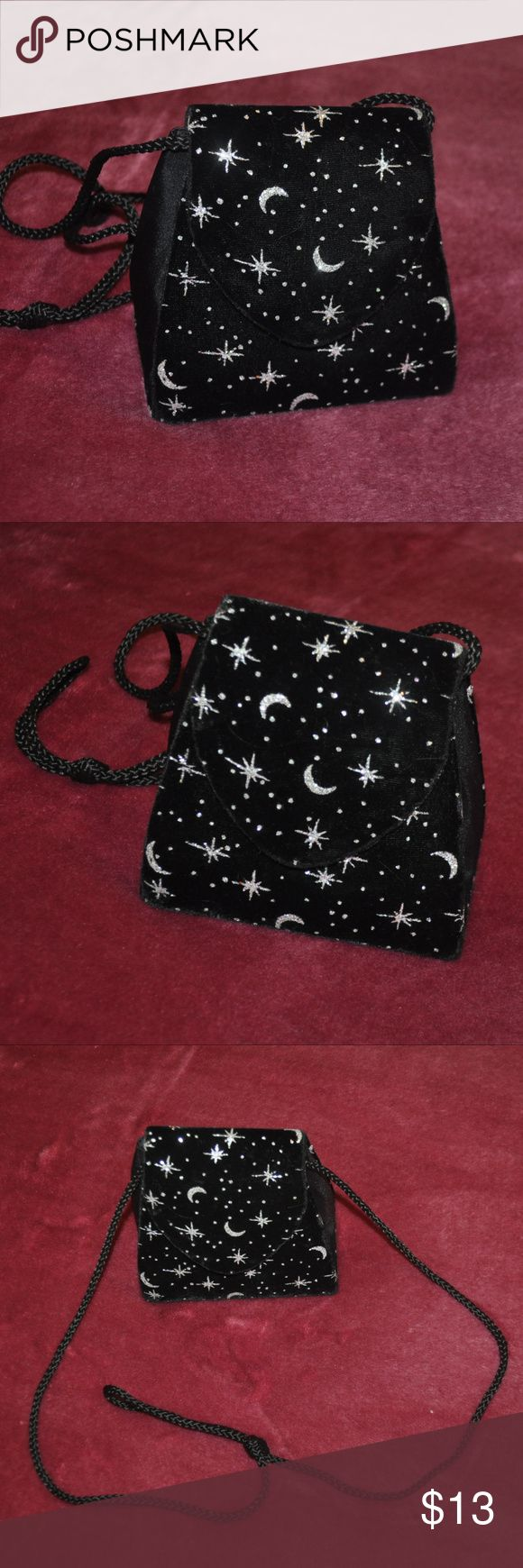Mini Velvet Moon & Stars Bag CUTE! snap button closure - silver sparkle moons and stars on black velvety fabric - black braided strap has a bit of what looks like makeup on the inside (please see photos) tags: witchy witchcraft witch craft goth gothic night casual date day summer style fashion adorable girly girl girls women womens occult vamp punk rock fun party small little size trendy trends trend wallet purse bags detail glittery glitter sparkly sparkles shiny shine sky cosmic galaxy