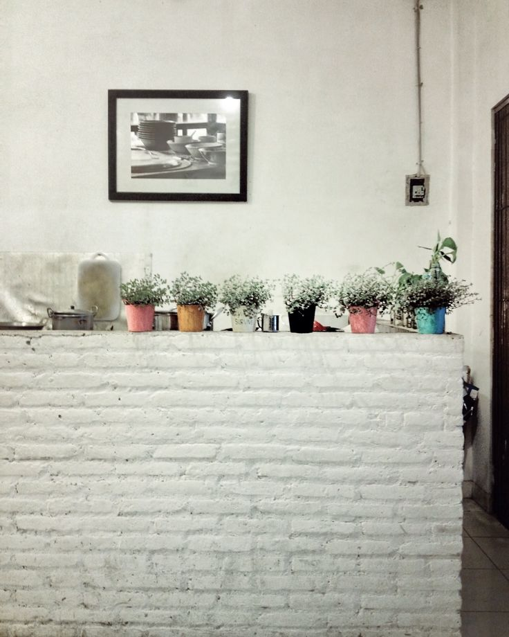 Everything grows from energy called love.  //white, wall, decoration, kitchen room, design, architecture, plant//