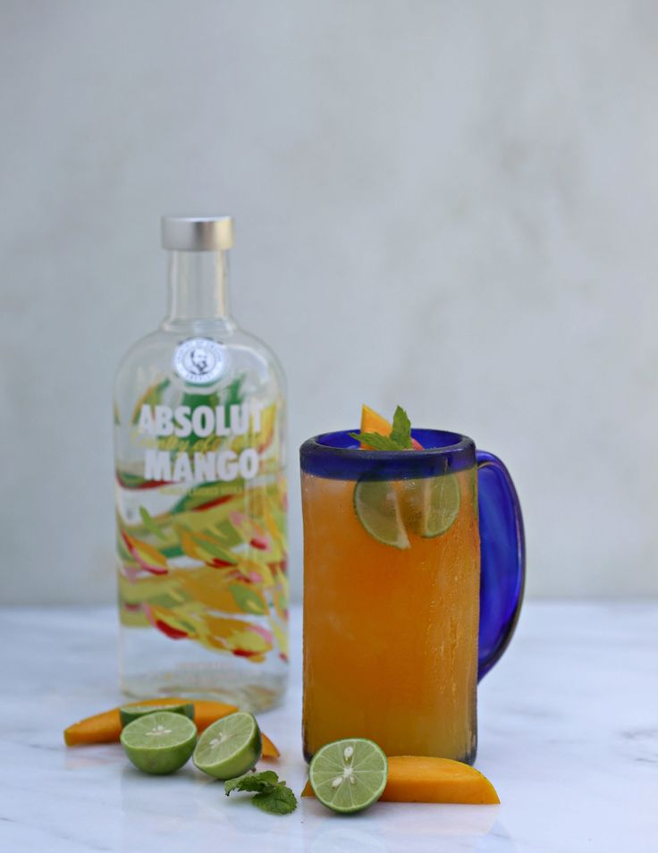 Absolut Mango Cooler - Absolut Mango Vodka gives brings the perfect punch to this rich, fruity cocktail and is made of 100% all natural ingredients. The Absolut Mango Cooler will quench your thirsty tastebuds and bring a delicious kick of mango flavor to your party. It's the perfect accompaniment to a juicy burger or a plate full of spicy tacos! #AbsolutNights @Absolut