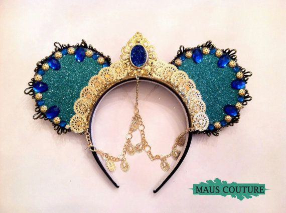 Get ready to jet set to the warm and exotic palace of Agrabah where this Princess Jasmine headpiece awaits! Covered in teal sparkle and dripping with