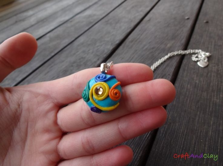 This quirky, unique and colourful pendant was made by me out of polymer clay and Swarovski rhinestone.  Would you like for this to become yours? You can find it here: https://www.etsy.com/au/shop/CraftAndClayUniverse?ref=hdr_shop_menu