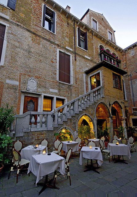 Quiet outdoor restaurant just in front of La Fenice operahouse, Venice.