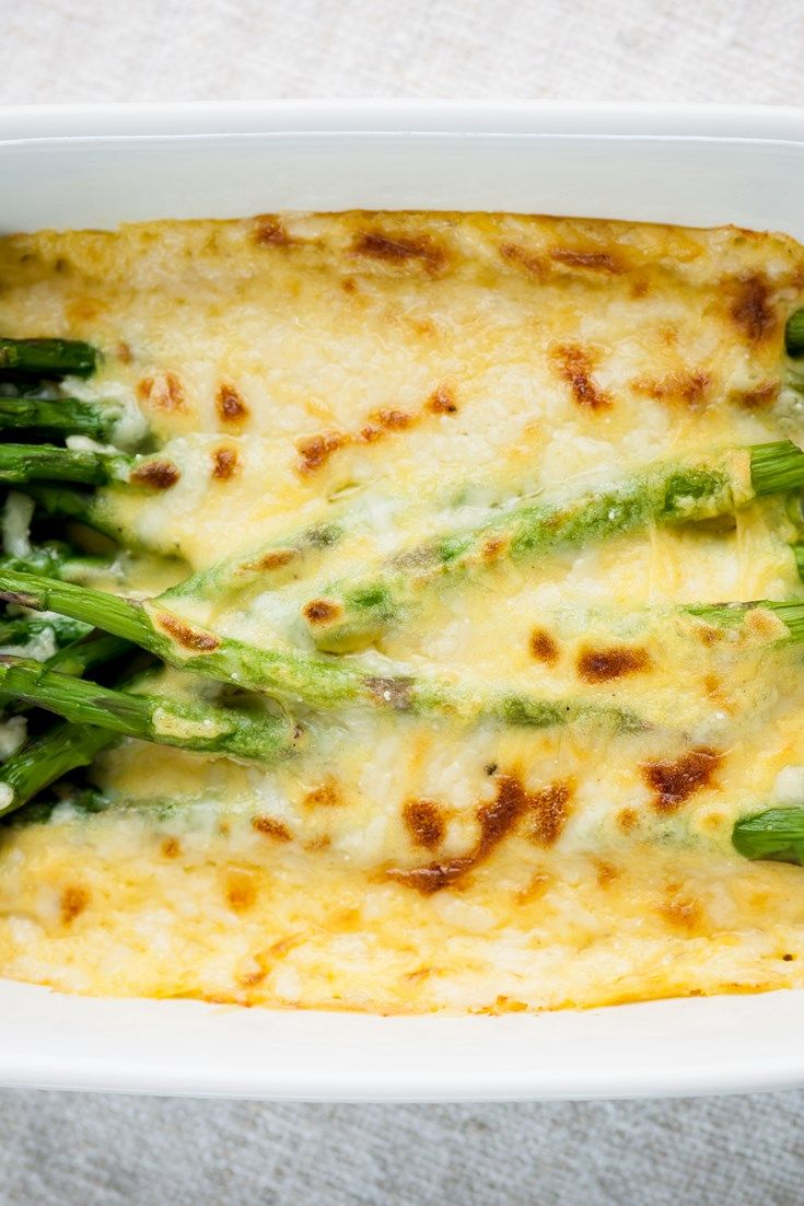 This baked asparagus recipe from Nathan Outlaw is a wonderfully cheesy treat for a starter or a side dish. This veggie recipe is a delicious way to enjoy asparagus.