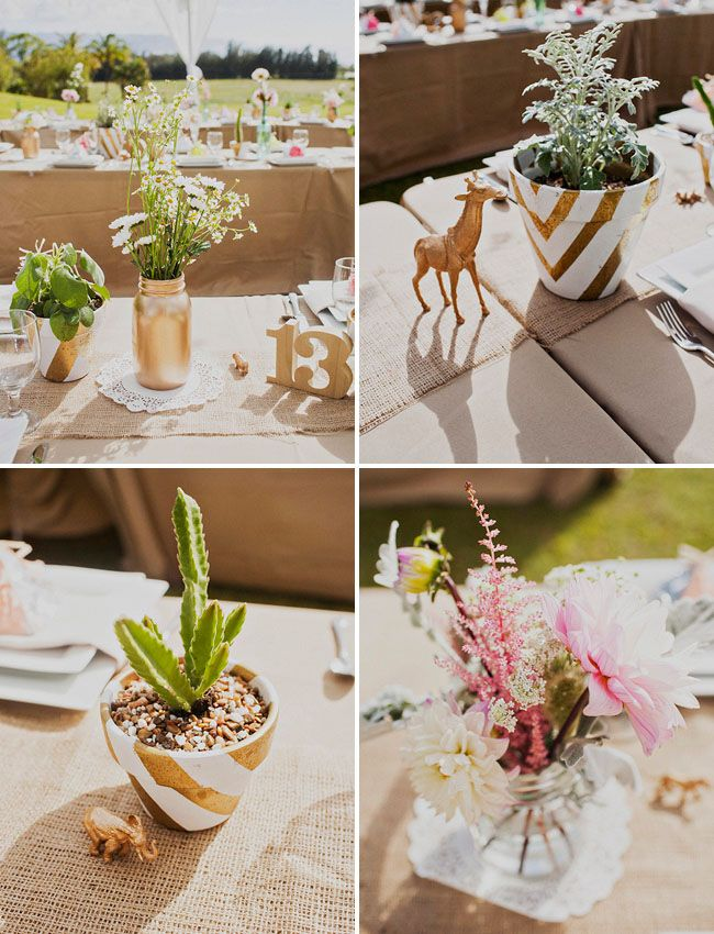 a sweet outdoorsy hawaiian wedding love the little details on the tables golden animal figures gold and white chevron potted plants and fun favor boxes