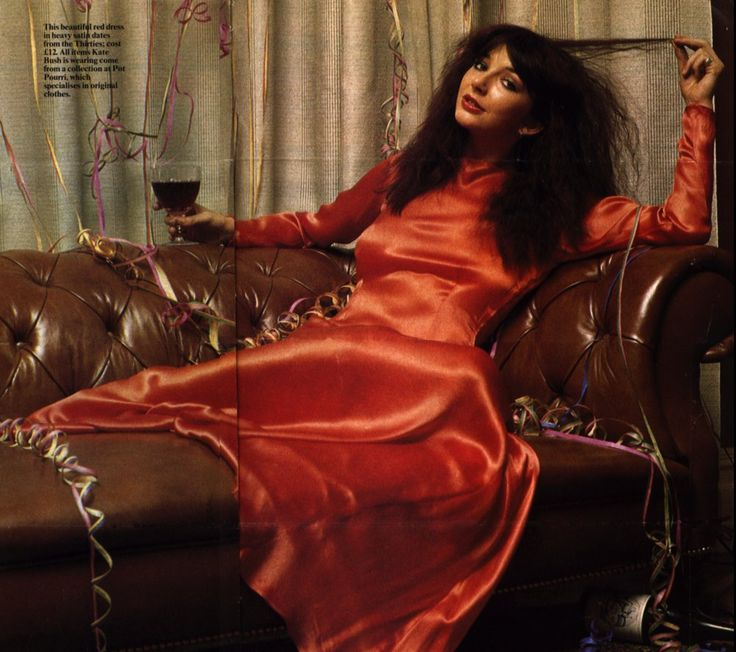 """Kate Bush in a 30's orange/red satin dress, picture is from an article """"Tales Of Christmas Past"""" by Jan Etherington, Christmas 1978"""
