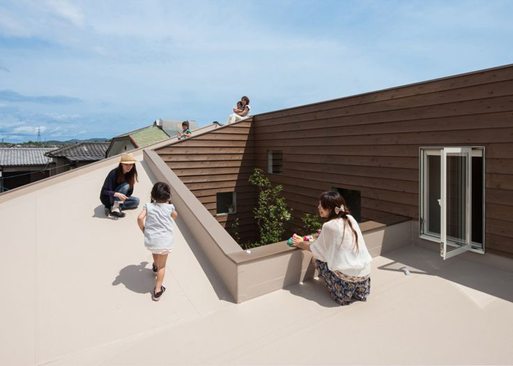 Rooms spiral up from a garden courtyard to a rooftop terrace at this family house in Japan's Yamaguchi Prefecture