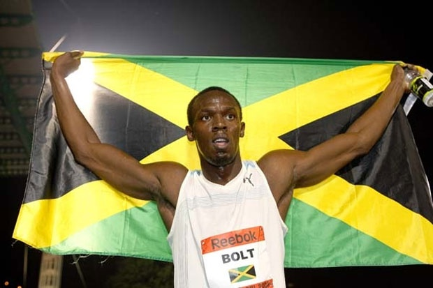 Usain Bolt with Jamaican flag. #Jamaica
