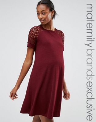 I like the color and lace detailing. The longer sleeve is also great. Not sure if the body part would be too loose feeling more like a tent. Usually prefer a more fitted look in body.