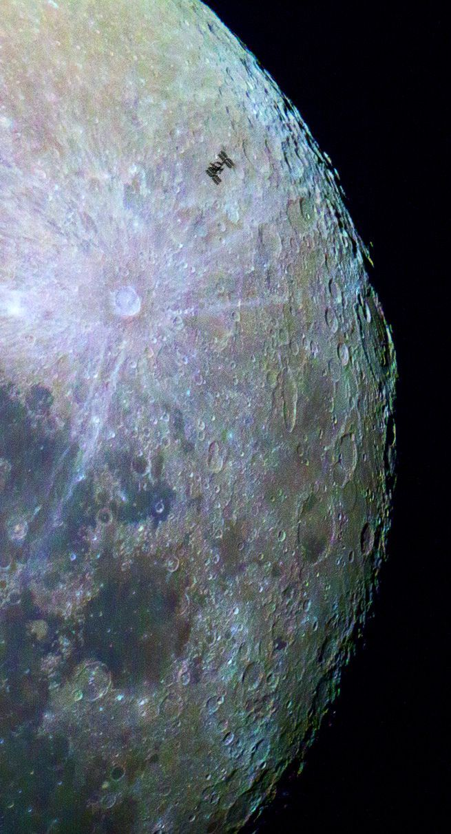 This sharp and detailed mosaic, recorded with telescope and digital camera, was seen from Byron Bay, NSW Australia on June 30, 2015. Showing the International Space Station amid a colorful lunar surface, the colors have been enhanced and processed in this image so that the different colors correspond to real differences in the chemical makeup of the lunar surface. Blue hues reveal titanium rich areas while orange and purple colors show regions relatively poor in titanium and iron. (NASA…