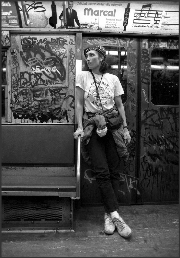 Lisa Sliwa, a member of the Guardian Angels and wife of its founder, Curtis Sliwa, patrols the subway dressed in her uniform with its signature red beret.