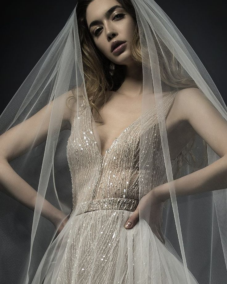 Close up on Ersa Atelier 2018 Miss Hunt couture wedding dress, an exquisite ensemble of diaphanous tulle, french lace and hand sewn sequins.