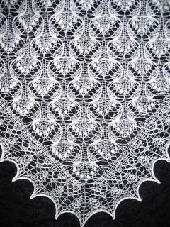 """This shawl pattern was designed for a contest on Ravlery.com """"10 shawls in 2010"""". It requires some lace knitting experience (provisional cast on, estonian nupps)."""