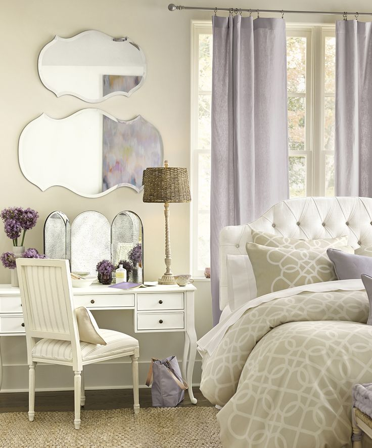 Accents of happy lavender feel feminine, but not overly girly, in this bedroom space