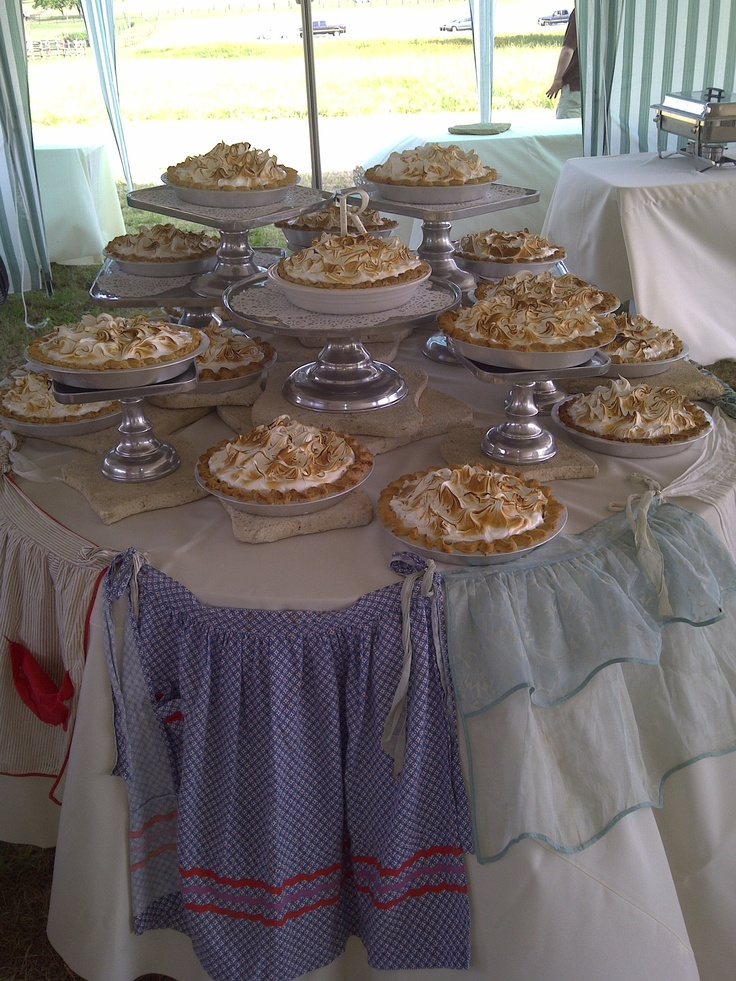 Lovely display that my sister Debbie did when she catered an outdoor country wedding! The couple chose to have my sister's delicious chocolate meringue pies instead of wedding cake! I love all the vintage aprons.