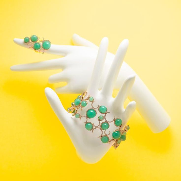 Christina Debs Candy Pop chrysoprase and diamond bracelet in yellow gold. On a yellow background with white maniquin hands. Ball shaped mint green gemstones on a ring and bracelet. For the fashion forward stylish women with fresh taste. http://www.thejewelleryeditor.com/jewellery/article/green-jewellery-trend-emerald-malachite-chrysoprase-jade-tsavorite/ #jewelry