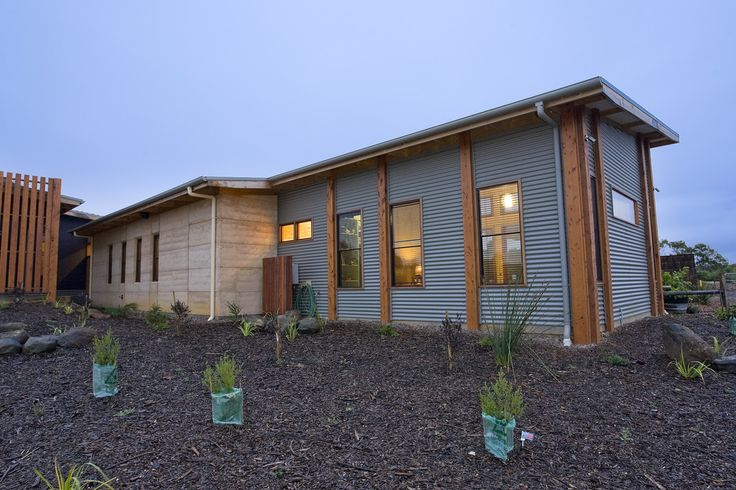 Corrugated iron rammed earth house