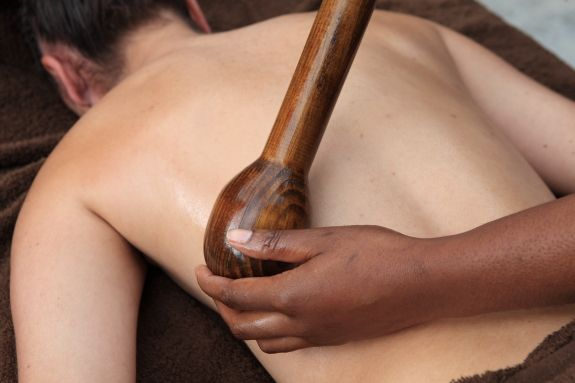 African Rungu  It's a long stroked, deep pressure massage that reduces pains and aches, improves blood circulation, lymph drainage and muscle toning and provides immediate relaxation