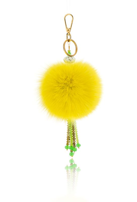 Pompon Bag Charm with 12cm yellow real fox fur, metal ring and clip, crystal beads and decorative elements.  Price: 42.00E