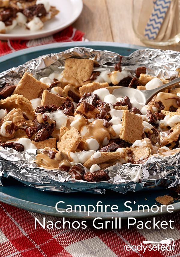Dessert nachos using traditional s'more ingredients with a twist of added crumbled brownie and creamy peanut butter made in a foil packet for easy clean up