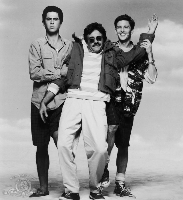 weekend at bernies  1989...I watched this movie soooo many times as a kid! I still can't imagine dragging a dead guy around the beach for a whole weekend! Lol!