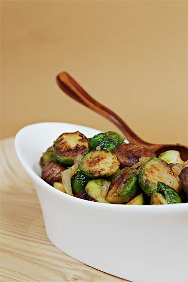 Maple-glazed pan-roasted Brussels sprouts with chestnuts.  I absolutely love LOVE Brussels sprouts ...unusual I know ;) I want to try these
