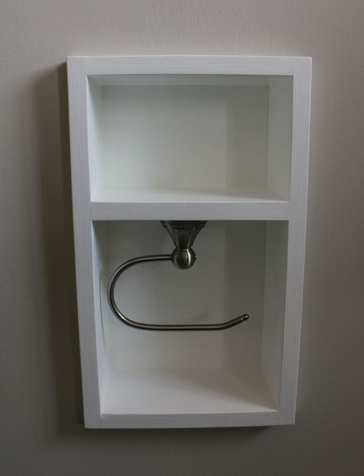 Create a wall niche between studs for extra bathroom storage. Use a Euro-style toilet paper holder for easy replacement. That top shelf would be great for little decor pieces or for holding a phone.