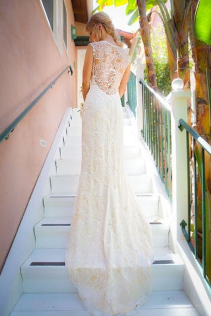 Lace Back Wedding Dresses - A long trail  adds to the royal feeling that this lace back wedding dress exudes.  #Lace #Wedding #Dress #Gown #Back