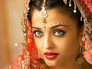 Traditional Bengali bride forehead makeup. I love it, though many don't do it any more.